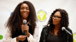 Tennis champions Venus Williams, left, and Serena Williams speak during a media availability on Friday, Nov. 7, 2014, in Washington. (AP Photo/Alex Brandon)