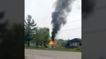 A witness' video shows flames and black smoke shooting high into the air from the trailer. Firefighters were able to contain the blaze and prevent it from spreading to a nearby house.