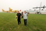 Premier Brad Wall, right, and Emergency Management and Fire Safety Commissioner and Executive Director Duane McKay tour water tanker planes at the airport in Prince Albert, Sask., on Tuesday, June 30, 2015. Greg Pender / The Star Phoenix / THE CANADIAN PRESS)