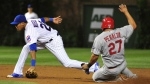Chicago Cubs second baseman Addison Russell is unable to force out St. Louis Cardinals' Jhonny Peralta during the seventh inning of a baseball game in Chicago on July 6, 2015. (AP / David Banks)
