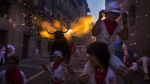 "A flaming fake bull known as a ""Toro de fuego"" runs after revelers during the 2015 San Fermin fiestas in Pamplona, Spain, Monday, July 6, 2015. (AP / Andres Kudacki)"