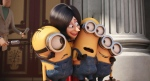 In this image released by Universal Pictures, Scarlet Overkill, voiced by Sandra Bullock, second left, appears with minions Stuart, left, Kevin and Bob, right, in a scene from the animated feature, 'Minions.' (Illumination Entertainment / Universal Pictures via AP)