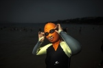A woman wearing a facekini poses at the beach in Qingdao, eastern China's Shandong province. (©AFP PHOTO / FRED DUFOUR)