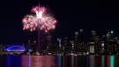 Fireworks light up the downtown Toronto city skyline during the closing ceremony for the Pan American Games in Toronto on Sunday, July 26, 2015. (Nathan Denette /  THE CANADIAN PRESS)