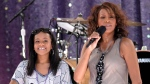 FILE - Singer Whitney Houston, right, sings with her daughter Bobbi Kristina Brown, in New York, on Sept. 1, 2009. (AP Photo/Evan Agostini)