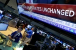 A television screen on the floor of the New York Stock Exchange shows the decision of the Federal Reserve, Wednesday, July 29, 2015. (AP/Richard Drew)