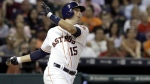 Houston Astros' Jason Castro watches the ball go over the wall for a three-run walkoff home run to defeat the Los Angeles Angels 3-0 in the ninth inning of a baseball game in Houston on July 30, 2015. (AP / Pat Sullivan)