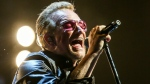 Bono of U2 performs at the Innocence + Experience Tour at The Forum in Inglewood, Calif. on May 26, 2015. (Invision / Rich Fury)