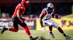 Montreal Alouettes S.J. Green, right, looks to avoid Calgary Stampeders Fred Bennett during first half CFL football action in Calgary on Saturday, August 1, 2015. THE CANADIAN PRESS/Jeff McIntosh