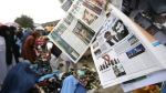 Newspapers carry headlines about the new leader of the Afghan Taliban, Mullah Akhtar Mohammad Mansoor, in Kabul, Afghanistan on Aug. 1, 2015.(AP / Rahmat Gul)