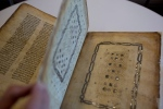 In this Oct. 5, 2014 file photo, a library official shows a Jewish manuscript. (AP / Sebastian Scheiner)