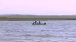 Crews search Lake McGregor for a missing boater.