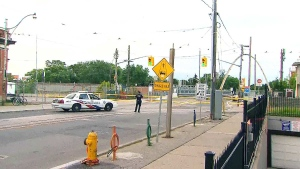 A police cruiser blocks the scene of a fatal shooting in Toronto on Tuesday, Aug. 4, 2015.