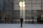 A man uses his phone near an Apple store in Beijing. Apple Inc., on April 22, 2014. (AP / Ng Han Guan)