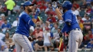 Toronto Blue Jays' Jose Bautista, left, celebrates his two-run home run against the Texas Rangers with teammate Chris Colabello during the third inning of a baseball game, in Arlington, Texas, Tuesday, Aug. 25, 2015. (AP / Tony Gutierrez)