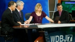 WDBJ-TV7 news morning anchor Kimberly McBroom, second from right, and meteorologist Leo Hirsbrunner, right, are joined by visiting anchor Steve Grant, second from left, and Dr. Thomas Milam, of the Carilion Clinic, as they observe a moment of silence during the early morning newscast at the station, in Roanoke, Va., Thursday, Aug. 27, 2015. (AP / Steve Helber)