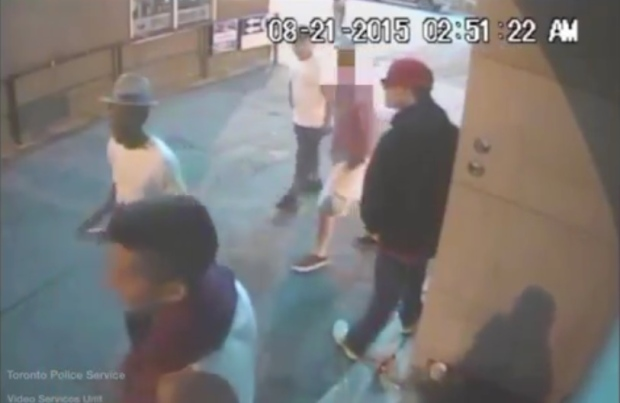 Suspects in the Aug. 21 assault and robbery of a 20-year-old man are seen in surveillance camera footage. (Toronto police)