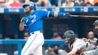 Toronto Blue Jays' Edwin Encarnacion, left, hits a three-run home run in front of Detroit Tigers' catcher James McCann during first inning MLB baseball action in Toronto on Saturday, Aug. 29, 2015. (Darren Calabrese/ /THE CANADIAN PRESS)