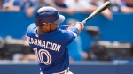 Toronto Blue Jays' Edwin Encarnacion hits a two-run home run during sixth inning MLB baseball action against the Detroit Tigers in Toronto on Saturday, August 29, 2015. (Darren Calabrese/THE CANADIAN PRESS)