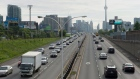 Vehicles crawl past the nearly empty Pan Am high-occupancy vehicle lanes as morning rush hour traffic crawls in Toronto on Monday, June 29, 2015. (THE CANADIAN PRESS / Frank Gunn)