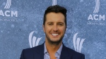 Luke Bryan arrives at the 9th Annual ACM Honors at The Ryman Auditorium in Nashville, Tenn. on Sept. 1, 2015. (Invision / Wade Payne)