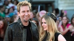 Chad Kroeger and Avril Lavigne are pictured in Toronto on June 16, 2013. (THE CANADIAN PRESS/Nathan Denette)