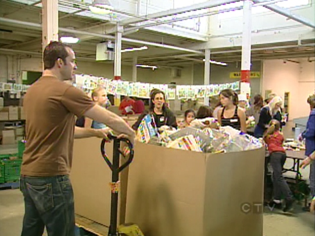 Volunteers sort food at the Daily Bread food bank in Toronto, Saturday, Oct. 11, 2008.