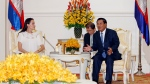 Hollywood actress Angelina Jolie Pitt listens to Cambodian Prime Minister Hun Sen, right, during a meeting at Peace Palace in Phnom Penh, Cambodia, Thursday, Sept. 17, 2015. (AP / Heng Sinith)
