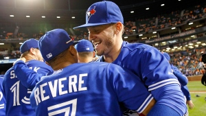 Toronto Blue Jays' Josh Donaldson, right, celebrates with teammate Ben Revere after winning the first baseball game of a doubleheader against the Baltimore Orioles, in Baltimore, Wednesday, Sept. 30, 2015. (AP / Patrick Semansky)