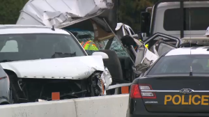Police say a collision that killed three people on Highway 401 in Ajax involved at least 15 vehicles and two tractor trailers.