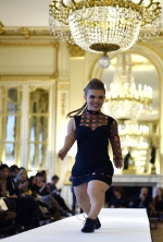 Bucking the fashion show stereotype of tall, willowy models, Paris Fashion Week was treated Friday to a parade of women of restricted growth sashaying along the runway to great public applause. (Domnique Faget / AFP Photo)