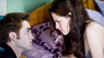 In this film publicity image released by Summit Entertainment, Robert Pattinson portrays Edward Cullen, left, and Kristen Stewart portrays Bella Swan in a scene from 'The Twilight Saga: New Moon.' (AP/Summit Entertainment, Kimberley French)