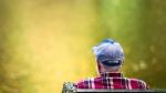 A man views reflected fall foliage Friday, Oct. 24, 2014, at the Wissahickon Valley Park in Philadelphia. (AP /Matt Rourke)