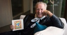 Jack Lenz, who wrote the Toronto Blue Jays 'OK Blue Jays' song poses for a photo holding a vinyl of the single, in Toronto. (Marta Iwanek / THE CANADIAN PRESS)