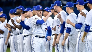 <b>American League Division Series: Game 1</b><br><br>Toronto Blue Jays&#39; Josh Donaldson (centre) greets teammates during player introductions before game one American League Division Series baseball action against the Texas Rangers in Toronto on Thursday, Oct. 8, 2015. (Nathan Denette / THE CANADIAN PRESS)