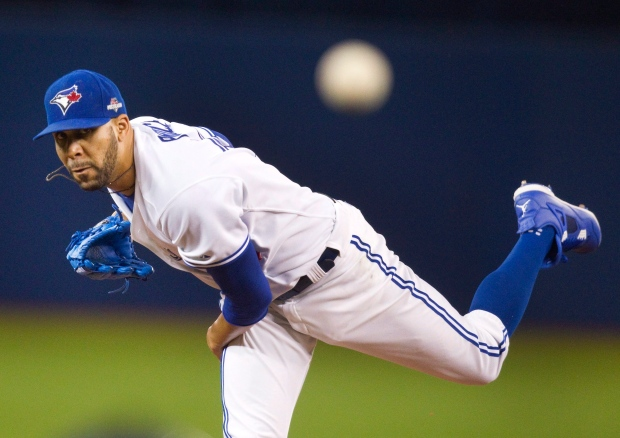 Toronto Blue Jays pitcher David Price throws against the Texas Rangers in the first inning of their MLB American League Division Series playoff game in Toronto, Thursday, October 8, 2015. (Pool - Fred Thornhill / THE CANADIAN PRESS)