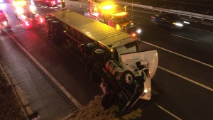 A truck is seen after rolling over on Highway 427 early Tuesday, Oct. 13, 2015. (Mike Nguyen / CP24)