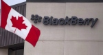 A Canadian flag flies at BlackBerry's headquarters in Waterloo, Ont., in this July 9, 2013 file photo. (Geoff Robins/THE CANADIAN PRESS)