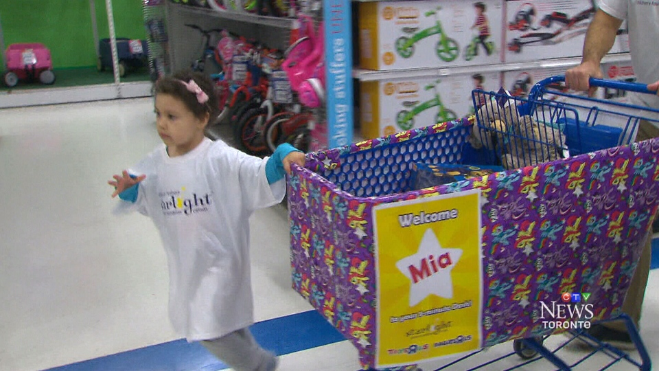 Mia Taylor races to pick out toys on Tuesday, Nov. 3, 2015.