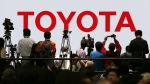 Toyota Motor Corp.'s booth is crowded with visitors in the media preview of the Tokyo Motor Show in Tokyo on Oct. 28, 2015. (AP / Shuji Kajiyama)