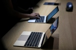 An Apple MacBook is on display in a demo room following an Apple event Monday, March 9, 2015, in San Francisco. (Eric Risberg/AP)