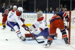 Montreal Canadiens goalie Carey Price (31) blocks a shot attempt by New York Rangers center Oscar Lindberg (24) as Canadiens defenseman P.K. Subban (76) looks for the rebound during the second period of an NHL hockey game on Nov. 25, 2015, in New York. (Julie Jacobson / AP Photo)