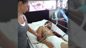 Joshua Aversa is seen in hospital in a family photo.