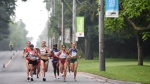 Canada's Rachel Hannah, Peru's Gladys Tejeda, and Brazil's Adriana Da Silva lead the race in the women's marathon during the 2015 Pan Am games in Toronto, Canada, Saturday, July 18, 2015. ( Harry How, Pool photo via AP)