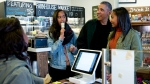 President Barack Obama, joined by his daughters Malia, left, and Sasha, right, orders at Pleasant Pops on Small Business Saturday in Washington, Saturday, Nov. 28, 2015. (AP / Carolyn Kaster)