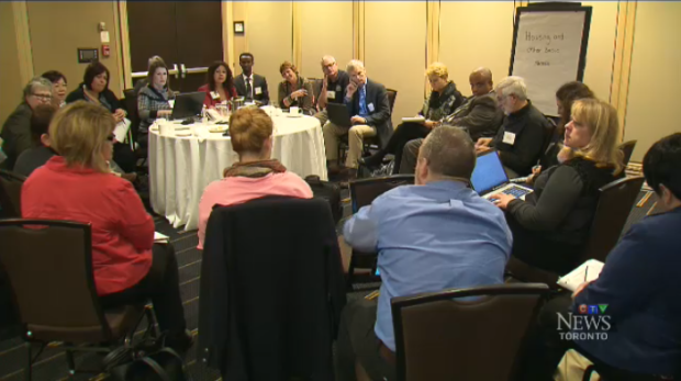 A group of organizations meet at a downtown hotel to discuss the influx of Syrian refugees in Canada.