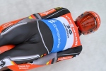 Felix Loch of Germany speeds down the course during his first run at the men's luge World Cup race in Innsbruck Igls, Austria, Sunday, Nov. 29, 2015. (AP / Kerstin Joensson)
