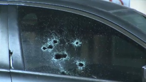 Bullet holes are seen in the window of a vehicle parked outside the Humber River Hospital's Finch Avenue campus on Monday, Nov. 30, 2015.