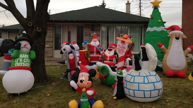 Take a break from the hustle and bustle of the big city to step back and admire its beauty. CTV News photojournalist George Stamou turns his lens on Toronto to capture daily life across our city.<br><br> Christmas decorations fill an Etobicoke lawn on Monday, Nov. 30, 2015. (George Stamou / CTV Toronto)