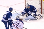 Toronto Maple Leafs goaltender Garret Sparks makes a save in front of Edmonton Oilers' Jordan Eberle as Maple Leafs' Jake Gardiner covers during first period NHL hockey action in Toronto on November 30, 2015. (Chris Young / The Canadian Press)